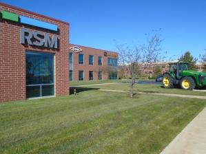 John Deere Building Exterior Shot - Southwest Elevation (RSM, Dow & John Deere Signage)
